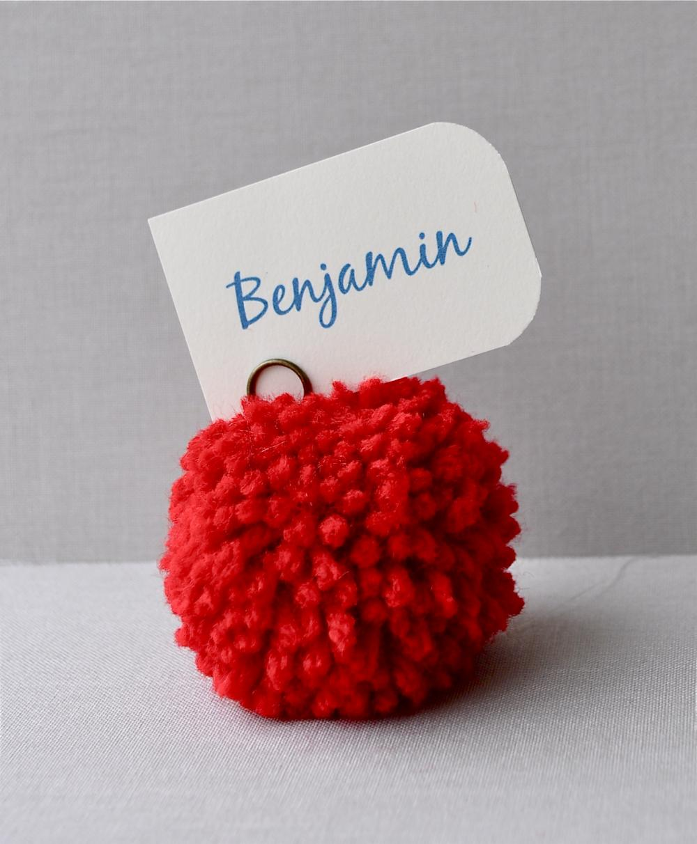 Red yarn pom pom place holders. Wedding decor, party decor, place settings.